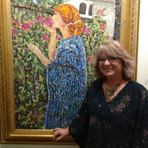 Artist Vivian Mosley with her painting of a lady smelling flowers