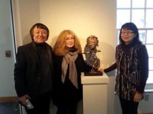 Peggy Sibila with two friends at gallery