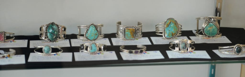 silver bracelets with turquoise stones by don gesaman
