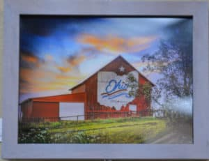 Photo of red barn with the state of ohio painted in white on its side by michelle wittensoldner
